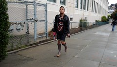 Castro Rain Boots (Lynn Friedman) Tags: sanfrancisco urban man rain leather fashion shirt umbrella boots cellphone style pedestrian rubber sidewalk jacket castro denim shorts knees wellies rollingstones wellingtons rainboots rolledcuffs lynnfriedman friedmanlynn