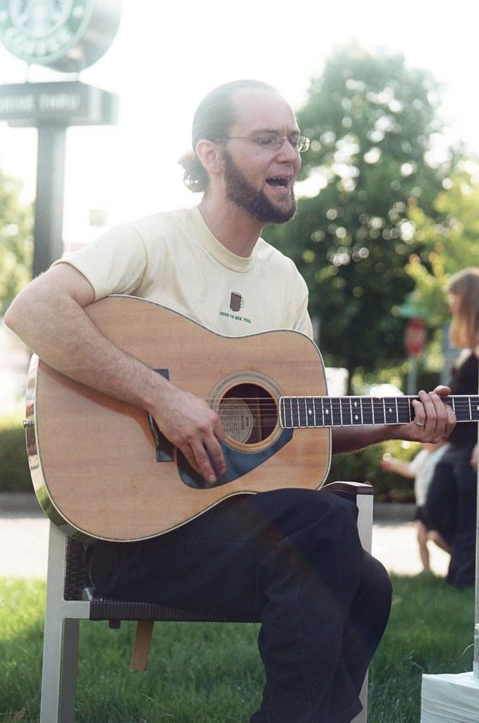 starbucks grand opening, 36th & powell: guitar player