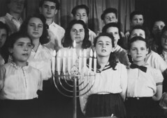 Hanukah at Landsberg DP camp (rosewithoutathorn84) Tags: girls holiday choir holocaust candles chanukah hanukah young jewish survivors menorah ushmm top20jewish