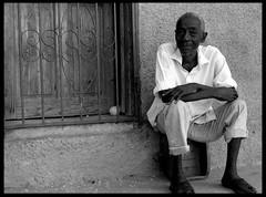 Morning in Cap Haitian (LindsayStark) Tags: travel portrait blackandwhite men haiti war conflict humanrights humanitarian humanitarianaid emergencyrelief waraffected