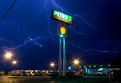 high energy (gsgeorge) Tags: longexposure blue storm night energy power god shell gasstation truckstop powerlines infrastructure oil kansas thunderstorm lightning semitruck climatechange i70 salina globalwarming peakoil salinakansas interstate70 semitrucks newtopography newtopographics shellgasoline petro2 newtopographic
