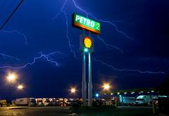 high energy (gsgeorge) Tags: longexposure blue storm night energy power god shell gasstation truckstop powerlines infrastructure oil kansas thunderstorm lightning semitruck climatechange i70 salina g