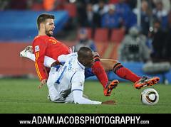 Gerard Pique tackles David Suazo at the World Cup (AdamJacobsPhotos) Tags: southafrica spain honduras tournament match worldcup venue johannesburg ellispark grouph