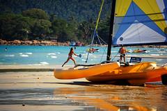 beach (mrkubi) Tags: blue sea playing beach boat sand sailing going transportation