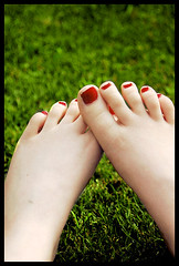 just the smell on the summer can make me fall in love (weare mockorange) Tags: red summer green feet grass outside nikon toes afternoon d70s july nikond70s nailpolish toenails 2007 rednailpolish redtoenails picswithframes