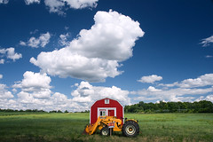 For Sale (John Baird) Tags: blue red sky tractor field grass clouds barn rural landscape countryside midwest forsale michigan farm country shed bigsky eastlansing roadside redbarn farmequipment outbuilding frontloader polarizingfilter littlefluffyclouds johnbaird canonefs1755mmf28isusm ishootpretty