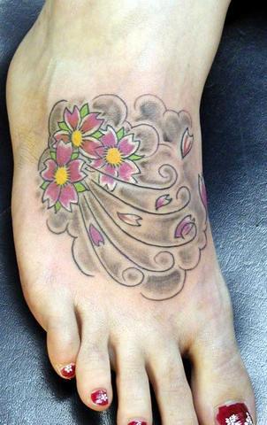 cherry blossom foot tattoo. blossom