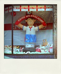 Come On England! (Mark Zuid) Tags: england window shop football support display flag soccer inflatable worldcup shopfront fakepolaroid fakefilm poladroid comeonengland poladroidnet