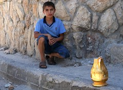 portrait of a boy and a pitcher (Michael.Loadenthal) Tags: kids israel palestine westbank military incursion israelipalestinianconflict israelandpalestine nablusregion askarrefugeecamp militaryinvasion westbankandgazastrip