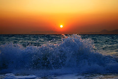 wave and sunset (esther**) Tags: ocean desktop blue light sunset red sea summer vacation sky orange sun sunlight seascape motion mountains reflection beach nature water colors june landscape island happy gold evening drops bravo holidays mediterranean mare waves view action colorfull air interestingness1 wave atmosphere sunny spray topf300 greece shore summertime splash greekislands topf100 seashore rhodes mashallah topf400 welltaken magicdonkey isawyoufirst holidaysvancanzeurlaub frhwofavs islandofrhodes