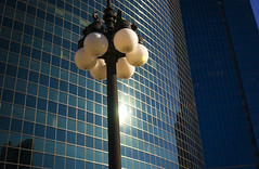 Chicago Street Light (Adam FLiK) Tags: street city blue light urban sun sunlight chicago reflection building glass landscape illinois nikon downtown il tamron f28 flik d1x 2875mm adamflikkema classicagainstmodern
