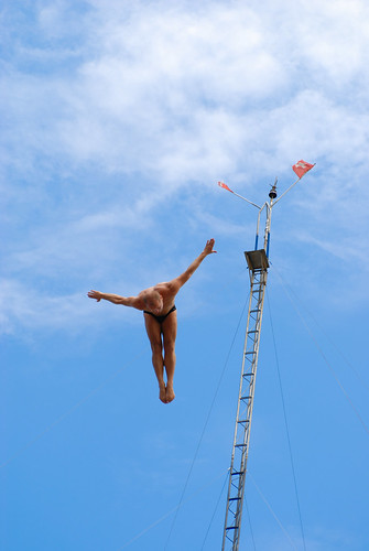 High diving with the same pose of the pole
