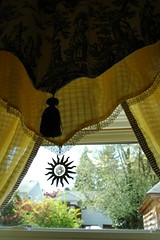 Toile drapes with sun crystal, and blue and cream border, handmade yellow curtains, kitchen, Seattle, Washington