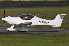 G-TOMX
