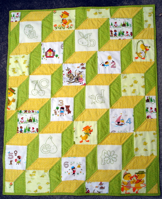 ABCs and 123s baby block quilt with embroidered squares