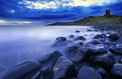 Early morning Dunstanburgh (Corica) Tags: uk longexposure greatbritain sea england water clouds sunrise landscape movement rocks britain northumberland northsea craster sigma1020mm dunstanburgh dunstanburghcastle northeastengland corica canon400d anlwickdistrict rumblechurn