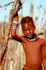 Another Himba child posing - Namibia (kryyslee) Tags: world pictures voyage africa trip travel red portrait color travelling colors girl face canon children rouge photography eos photo gesicht foto tour child faces image photos pics earth couleurs picture posing images tribal du adventure explore round terre around tribe christophe monde backpacker amateur enfant pict namibia autour couleur indigenous visage himba afrique tribu aroundtheworld aventure namibie visages tourdumonde 50d 400d himbas eos400d kryyslee christophepaquignon paquignon