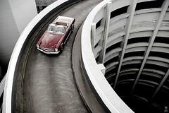DSC_0175 (romanraetzke) Tags: auto red rot classic car nikon d70 parking hamburg convertible 2006 september chrome mercedesbenz oldtimer schnecke chrom cabriolet parkhaus pagode mundsburg 230sl klassiker digitak