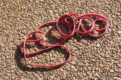 Kirsty Hall, photograph of red rubber bands