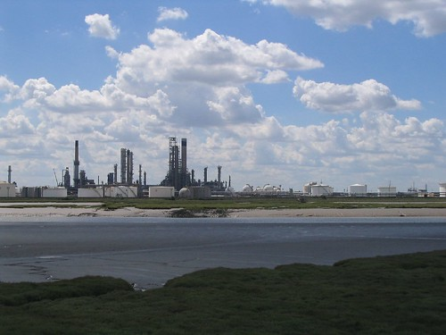Photo:Upper Horse Island with its man-made, mysterious enclosure, keeping its mystery in front of a skyline backdrop of some nightmarish city of the future. A view to Shell Haven and Coryton. We may love it or hate it, but we cannot live without it. Pipes and jetties, mud-based and steeped in past activities.
