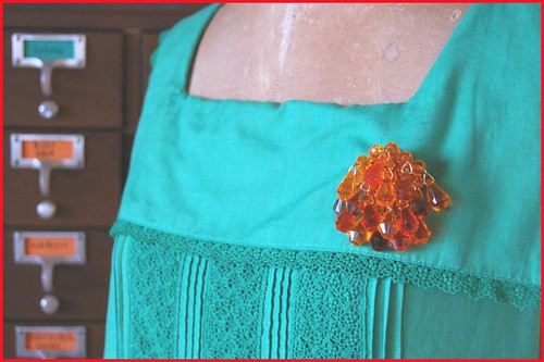 orange beaded brooch