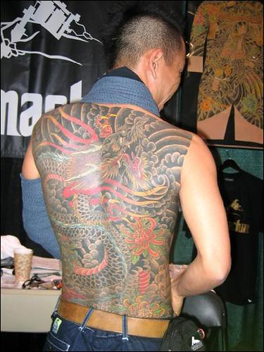 Japanese dragon tattoos can wrap around the body and flatter the contours of