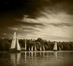 I ain't here to paint no pretty little picture (Evelyn Arthur Richman) Tags: trees blackandwhite lake tree water sepia clouds landscape boats boat mood sailing moody cloudy bnw bwdreams supershot flickrsbest 25faves excellentphotographerawards