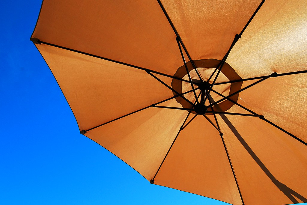An umbrella against the blue sky.