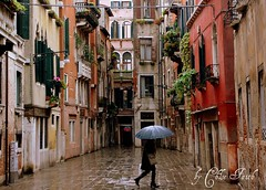 Umbrella (ChloeFaith) Tags: street city venice houses homes italy wet colors rain umbrella buildings canal calle interesting alley colorful mediterranean italia european walk faith pedestrian chloe end venezia dei sinking botteri tripleniceshot chloefaith calledeibotteri