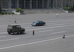 Kids having fun in the middle of the road - Pyongyang North korea (Eric Lafforgue) Tags: voyage road travel color colour cars car kids danger kid war asia capital korea voiture route asie capitale rue 2008 coree couleur northkorea trafic ideology axisofevil pyongyang eastasia dprk coreadelnorte juche nordkorea dictature 1279 democraticpeoplesrepublicofkorea    koreanpeninsula coreadelnord  juchesocialistrepublic coreedunord rdpc  insidenorthkorea  rpdc  northkoreanarmy kimjongun coreiadonorte