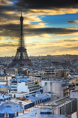 Eiffel Tower and Paris Roofs at sunset | davidgiralphoto.com (David Giral | davidgiralphoto.com) Tags: light sunset sun david paris france tower clouds landscape soleil nikon cityscape cloudy dusk over rays d200 fading arcdetriomphe soe hdr couchant giral effeil 3xp nikond200 18200mmf3556gvr tthdr shieldofexcellence copyrightdgiral davidgiral flickrplatinum superbmasterpiece 22hearts