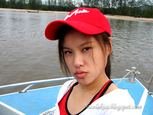 posing on boat