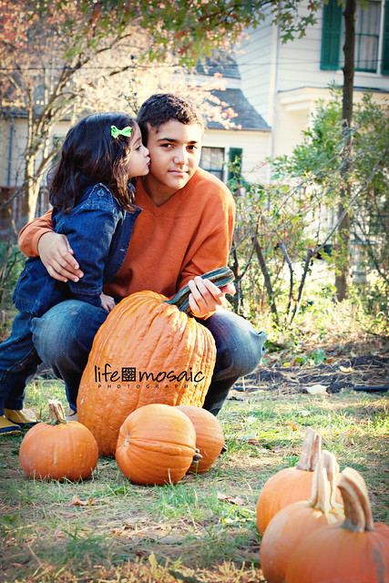Kids Kiss Pumpkins