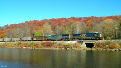CSX 830 and 4776 (Trains & Trails) Tags: railroad november autumn trees fall water leaves train diesel pennsylvania scenic engine foliage locomotive coal shipping ge freight 830 generalelectric csx fayettecounty youghioghenyriver emd gevo sd70mac 4776 es44ac electromotivedivision southconnellsville keystonesubdivision scwx openhoppers u306 southcarolinapubicserviceauthority