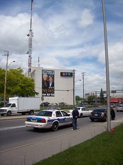 Traffic infraction on Merivale Road. (Steve Brandon) Tags: auto ontario canada ford car geotagged automobile ottawa tvstation voiture policecar network suburb mast nepean antenna antennae ctv  broadcasttower tvstudio affiliate policecruiser patrolcar crownvic fordcrownvictoria televisionstation  ycdtotv cjoh  policeinterceptor youcantdothatontelevision 2871 ctvnews merivaleroad  merivalerd ottawapoliceservice cjohtv broadcastmast ruemerivale clydeavenue   ctvottawa maxkeeping carolannemeehan broadcastantenna   pendragonpub