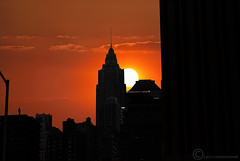Waiting for the Day (Leazwen) Tags: nyc newyorkcity sunset shadow red orange sun man black rot skyline clouds photoshop person waiting highrise empirestate mann sonne schwarz hochhaus raise untergang aufgang umrisse nikond60 konturen