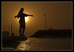 Silhouetes- the freedome () Tags: art water photo nikon photographer gulf arab kuwait d200  artphoto silhouetes       kuwai  maithamkhraibut  maitham khraibut  kuwaitphoto superbmasterpiece artphoto kuwatartphoto khuraibet alkhuraibet kuwaitartphotographer   khraibutnet