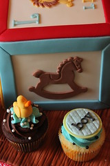 Rocking horse side (Andrea's SweetCakes) Tags: wood boy cake cupcakes bottle buttons lion ducky rockinghorse babyshower safetypin baseballglove buildingblock