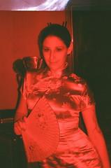 Dragon Lady / winding mishap (Kilgub) Tags: halloween fan redflash jillian faketattoo fujisuperia400 holga120cfn fakebeard 35mmadapter brooklynwinery