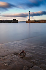 Newhaven Harbour (ajnabeee) Tags: longexposure light sunset lighthouse house motion blur water clouds boats big movement rocks edinburgh harbour dusk tide ring forth lee anchor newhaven cobbles firth stopper firthofforth shahbazmajeed