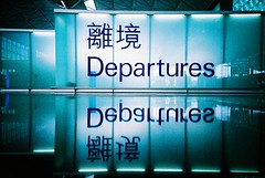 lonely departures (* andrew) Tags: blue color reflection film hongkong mirror airport lomo lca crossprocessed xprocess ct slide lobby international 100 agfa tunnelvision photooftheday 32mm precisa ratview