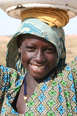 Smile ! (Ferdinand Reus) Tags: africa travel girl milk child lait mali djenne mopti afrique  peul aplusphoto