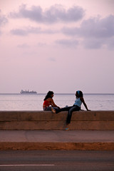 La Havana, Cuba, 2006 (Photox0906) Tags: girls sunset sea mer evening cuba cargo malecon conversation soire chatting soir tanker filles coucherdesoleil lahabana lahavana elmalecon lahavane merdescarabes