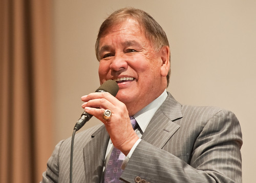 "Billy Mills is the only American to win the 10,000 meter run in the Olympics and did so at the Olympic Games in Tokyo, Japan in 1964. Mills, a Lakota raised on the Pine Ridge Indian Reservation became interested in long distance running and earned a scholarship to the University of Kansas making All-American seven times. After graduating from the University of Kansas, Mills was commissioned an officer in the United States Marine Corps, and continued training for the Olympic Team. He eventually qualified in two events the marathon and 10,000 meter run and to this day is the only American to win Gold in the 10,000 Meter Run. Mills was the keynote speaker at the United States Department of Agriculture, National American Indian and Alaska Native Heritage Month ceremony, ""From the Roots of Our Past Grow the Promises of Tomorrow,"" held in Washington, DC, Tuesday, November 9, 2010."