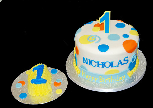 blue, yellow and orange 1st birthday cake and smash cake