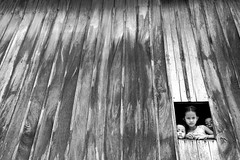 Wallflowers #2 (Wen Nag (aliasgrace)) Tags: wood bw home window girl wall kids rural blackwhite topf75 asia cambodia southeastasia forsakenpeople siblings 50100fav wallflowers kampongcham cotcpersonalfavorite angkorphotographyfestivalcontest
