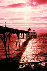 Sensia Magic... (Trapac) Tags: pink sunset sea summer england film silhouette pier xpro crossprocessed fuji arches slidefilm nikkor50mmf18 ra sensia clevedon northsomerset nikonf80 100iso clevedonpier fujisensia wmh explored fujira passionatelypinkforthecure gtap310110