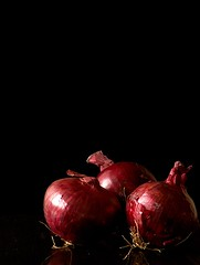three red onions (lesbru) Tags: red vegetables lowlight onions domestic dimagez3 redonions darknessandlight diamondclassphotographer flickrdiamond