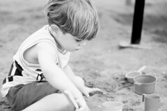 Sandcastle (Danni Guzzi Schmidt) Tags: boy bw white black cute playground canon fun eos rebel sand child play daniela sandcastle sandbox guzzi xsi zwicker 450d dzguzzi
