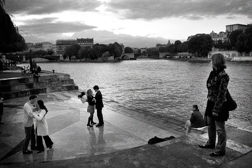 Lovers dance a winter tango on a quay along the Seine.